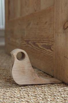 Wooden bird doorstop. nice. www.designbytimber.co.uk
