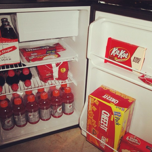 On Valentine's Day, a couple of years ago I totally spoiled my hubby by surprising him with a mini fridge for his office. I filled it with all his favorite red foods and drinks. Totally corny, but he loved it. | Instagram http://web.stagram.com/n/theperfectpalette/