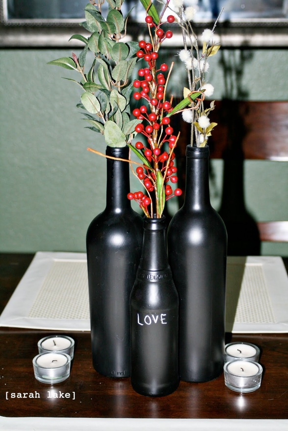 Chalkboard painted wine bottle centerpiece something for Painted wine bottle wedding centerpieces