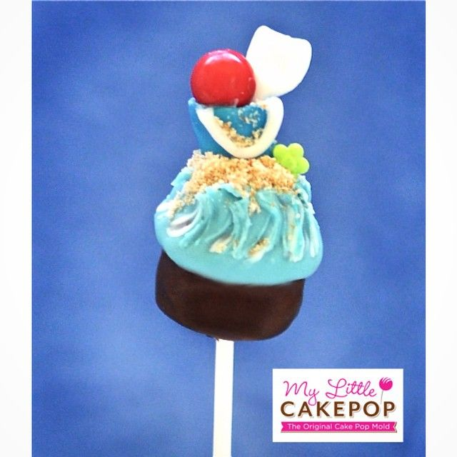 Another fun #cupcakepop idea for #memorialday or #summer!  The bucket and shovel are made out of fondant.  Beach ball is a gumball and sand is brown sugar. #cakepop #cakepops #cupcakepopmold #mylittlecakepop