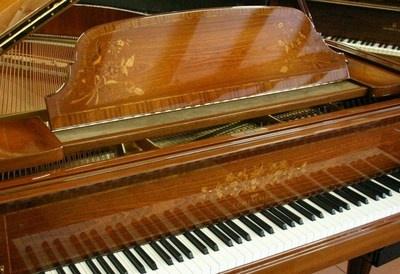 "Schimmel 5'10"" grand piano in inlaid empire mahogany"