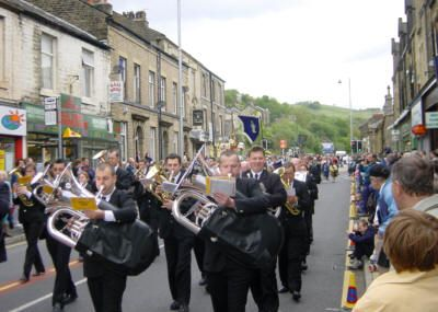 Whit Walks  Every year on Whit Friday (the Friday after Whit Sunday), members of the various churches in Mossley parade to the Market Place, where they assemble for an inter-denominational service of witness.