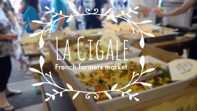 La Cigale French farmers market by Everywhere you go.     La Cigale is tucked away behind other buildings on St Georges Bay Road and is a little hidden slice of delectable France in the inner city. Owners Elisabeth and Mike Lind travel regularly to France and bring back the very best of wine, food, antiques and textiles for Auckland's Francophiles and serve French style food from their cafe.