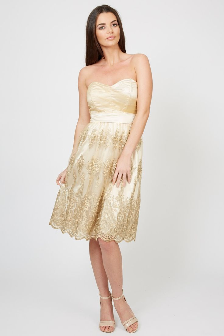 TFNC Party Dress<br /> <br /> - Delicate chiffon fabric<br /> - Bandeau style<br /> - Gold floral embroidery <br /> - Floaty pleated skirt with underlay <br /> - Exposed zip to reverse<br /> - Midi length <br /> <br /> Care: 100% Polyester. Lining: 97% Viscose, 3% Elastane. Hand Wash Only