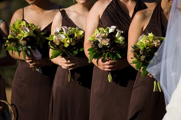 all different dress styles, but the same bouquet...beautiful