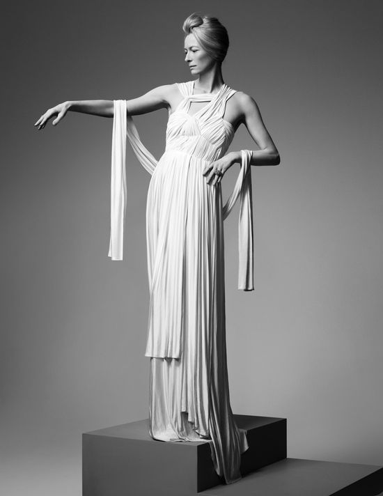 Tilda Swinton in an amazing white dress by the Greek designer in Sophia Kokosalaki, posing like a Greek goddess. Don't you think that this dress with the elegant Grecian draping can be worn by a modern bride that loves classic style?