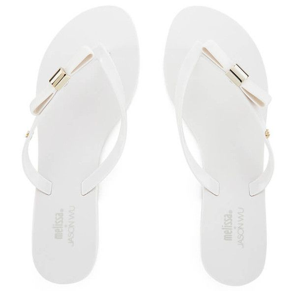 Jason Wu for Melissa Women's Harmonic 15 Flip Flops ($85) ❤ liked on Polyvore featuring shoes, sandals, flip flops, white, melissa shoes, bow t-strap sandal, white bow sandals, metallic strappy sandals and metallic sandals
