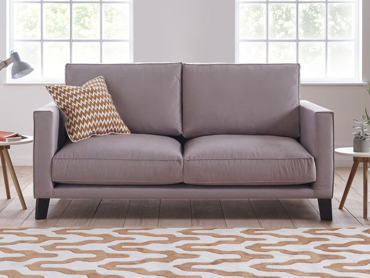 Leon Sofa - Also available as a corner sofa, Leon's unmissable plush cushions, upright armrests and angled wooden feet make an eye-catching sofa of wonderful comfort and class - by www.livingitup.co.uk