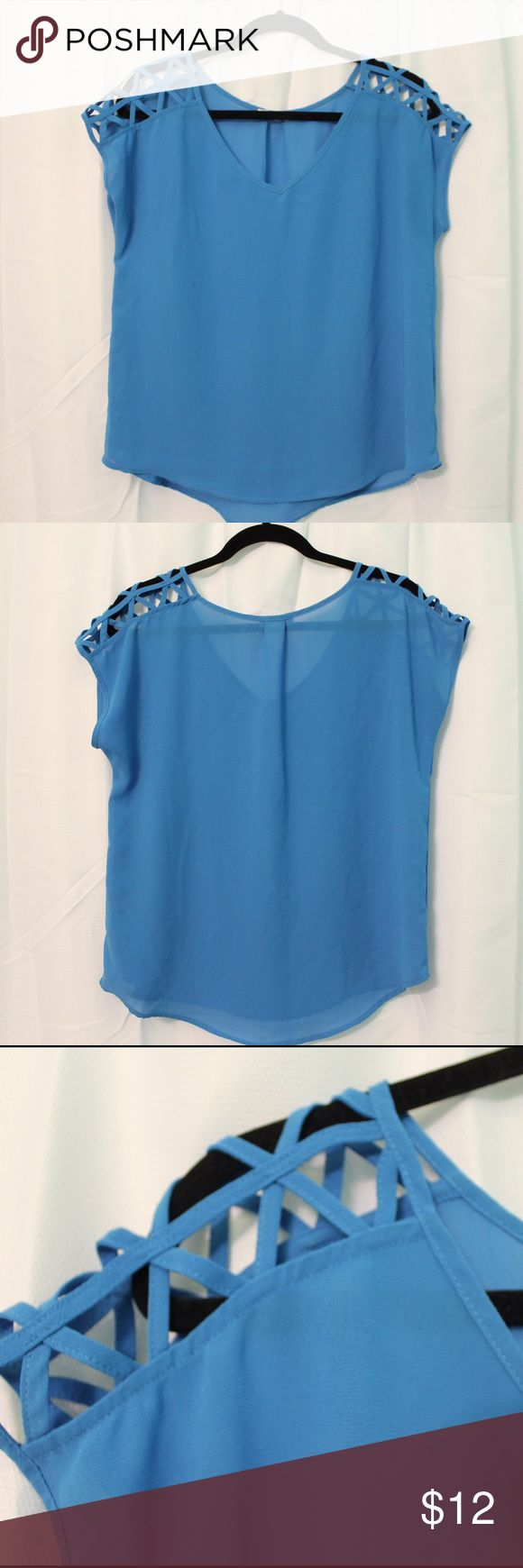 Blue Short Sleeve Top with Shoulder Detail Short sleeve top with awesome criss-cross design on the shoulders. Shoulder shirts are totally in right now! Light weight material and a great color! Long enough to be worn with leggings or jeans. (Not Tobi just listed for exposure). Tobi Tops Tees - Short Sleeve