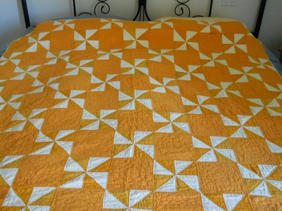 vintage 1930's handmade quilt.   pinwheel and plain block two colors very nice and easy.