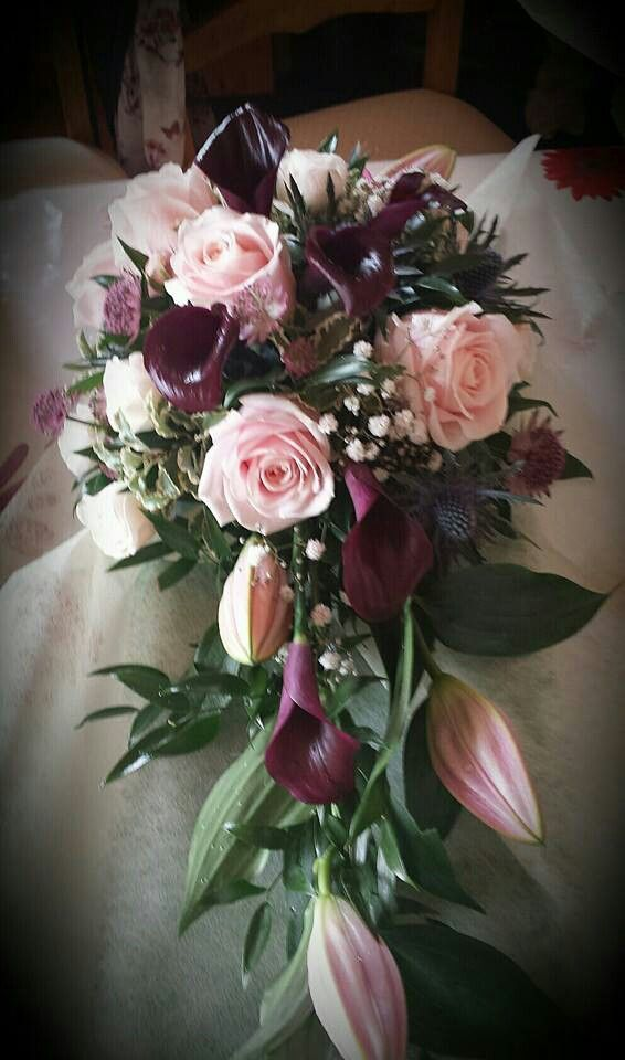 My beautiful wedding flowers - teardrop bouquet calla lilies, roses, thistles in aubergine and pink.