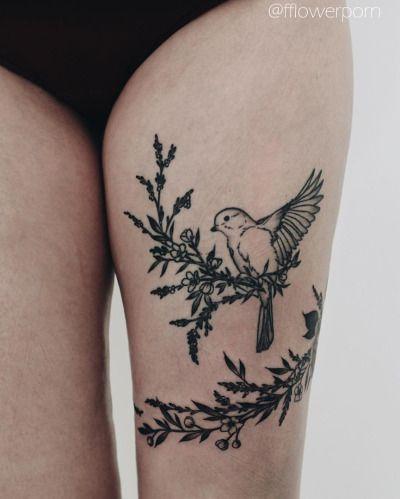 Olga Nekrasova - bird with branches tattoo