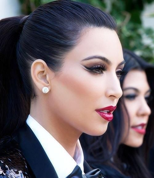 Kim Kardashian on the set of the Kardashian/Jenner Kristmas kard