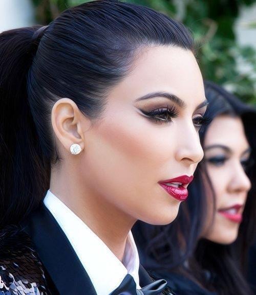 Kim Kardashian on the set of the Kardashian/Jenner Kristmas kard