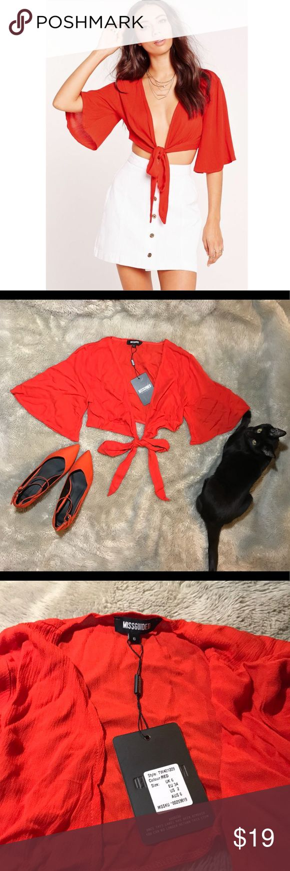 NWT missguided Red Orange wrap crop top 🍊 Cute n bold! Gorgeous red orange colored wrap top from missguided. Light summer material. super cute, the only reason I'm selling is bc it's a little too small for me :( Just needs a little steaming!  Halloween kitten not free w purchase! Sorry 😂🖤🖤🖤 Missguided Tops Blouses
