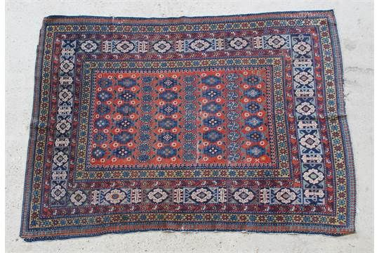 """A Caucasian style brown ground rug with medallion to the centre within multi row borders 76"""" x 53"""