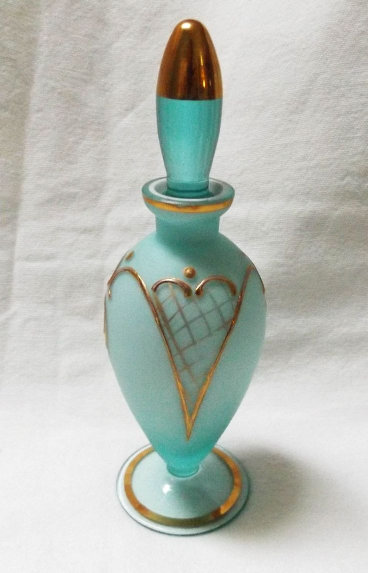 This vintage satin glass perfume bottle is a work of art.  It was first blown into it's beautiful form with a transparent blue glass and it's base,