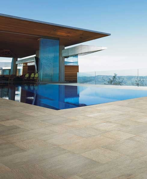 #Porcelain #pool surrounds create a chic complement to the modern architectural design of the facade of this home. #UnionTiles