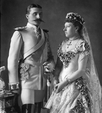 Princess Beatrice of the United Kingdom wearing a tiara of diamond stars given to her by her mother on the occasion of her marriage to Henry of Battenburg. She is alos wearing Victoria's wedding veil of Honiton lace. She was the only one of Victoria's daughters to be given the privilege of wearing her mother's veil. Her wedding took place on the Isle of Wight.