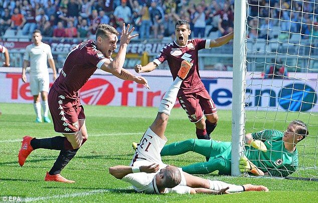Torino's Andrea Belotti (left) celebrates opening the scoring with his fifth goal of