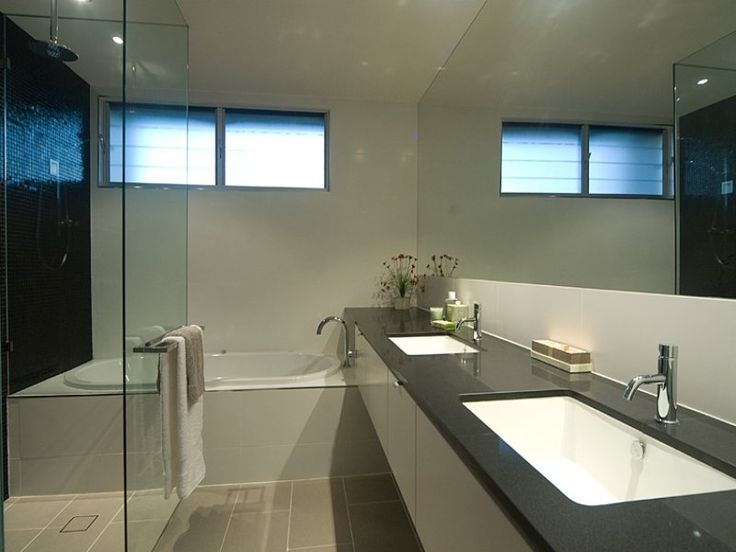 Black vanity top, white cupboards, grey floor and wall tiles, black mosaic feature wall tiles