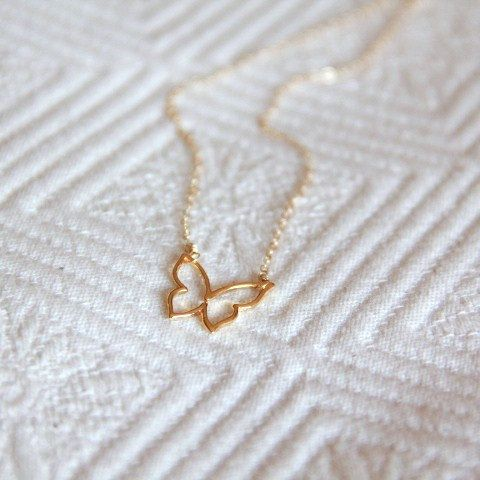 Thin gold chain + cute little charm = one of my favorite things.
