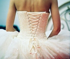 Just cannot decide which I love more - the corset tie up, OR straight buttons down the back. Ahh!