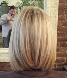 Natural icy blonde color with dark ash & neutral lowlights. Compliments natural dark blonde roots.