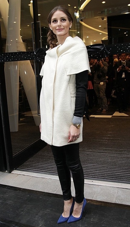 Her cowl neck ivory coat was worn over a black sweater and combined with a pair of Emily D Vegan leather leggings. Cobalt-colored suede Manolo Blahnik BB pumps rounded out the look.