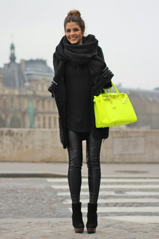 Black coat, knit jumper, infinity scarf, leather jeans, neon bag and leather booties