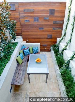Only 3.5m-wide and 6m-long, this compact outdoor room design was a challenge for OUTHOUSE Design. The homeowners wanted an inviting garden that also had a relationship with the modern interior of the home. OUTHOUSE Design's solution was a natural timber feature wall at the back that included rust panels paired with sandstone pavers and thoroughly considered plant, seating and barbecue placement. outhousedesign.com.au
