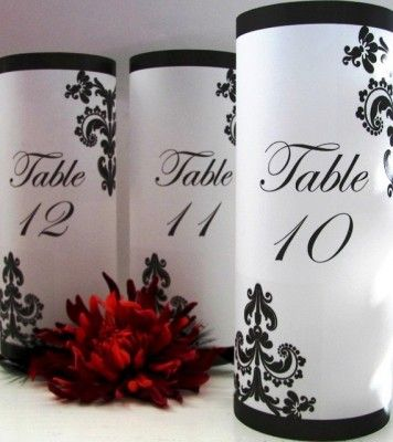 Some of our brides will incorporate the table number and the centerpiece into one.    Gothic Style Weddings   Gothic style table number luminaries - etsy.com