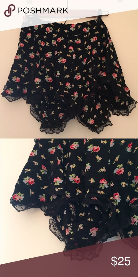Free people intimately lace trim shorts Super comfortable black lace trim shorts with elastic band. Adorable multicolor flower print! Worn under 10 times and in great condition. So comfortable!! Free People Shorts