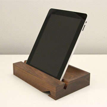 Solid iPad Stand Walnut  by Dario Antonioni  Orange 22's Solid iPad Stand is a paradigm of the principle that great design marries beauty and function. This handsome, handcarved walnut stand is made to cradle your iPad at both 62 and 28 degree angles for hands-free adoration regardless of your position.