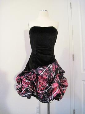 Favorite Camo Prom Dress is only $295! Strapless black velvet with camo satin pick up skirt. Shown in the popular MUDDY GIRL CAMO!! We can sew it for you in any camo pattern and in different lengths as well.