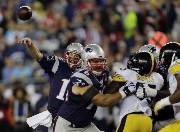New England Patriots quarterback Tom Brady, left, passes against the Pittsburgh Steelers in the first half of an NFL football game, Thursday, Sept. 10, 2015, in Foxborough, Mass. (AP Photo/Charles Krupa)