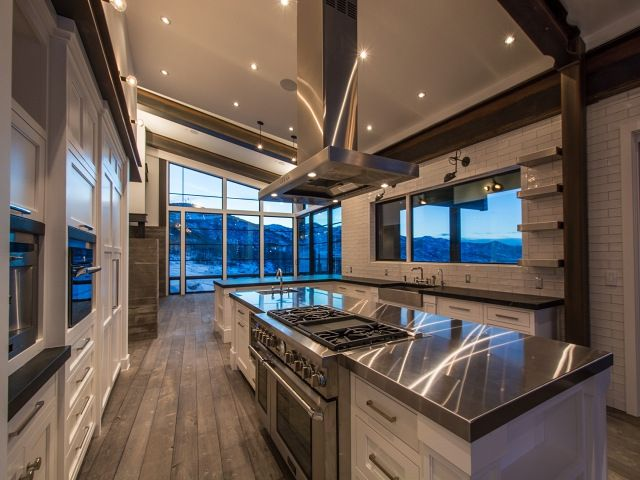 Amazing kitchen features a sloped ceiling over a kitchen ...