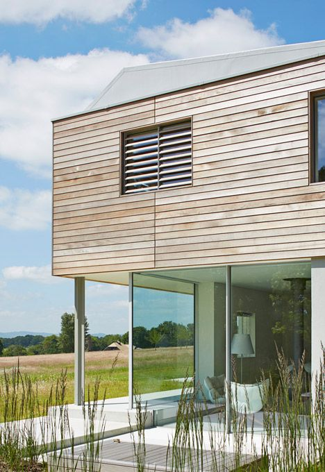 Sussex House by Wilkinson King Architects features red cedar cladding.