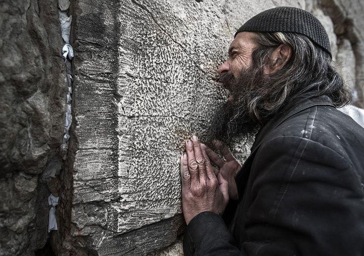 find more http://earth66.com/human/man-praying-wailing-wall-jerusalem/