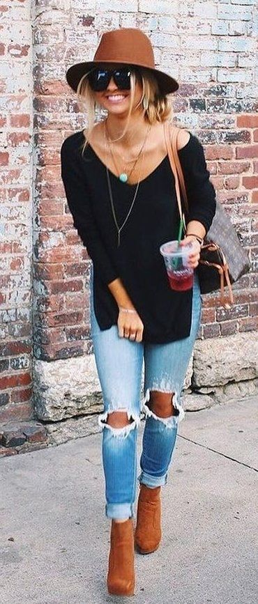 #fall #outfits  women's black off-shoulder long-sleeve shirt, blue distressed denim jeans, and brown leather boots