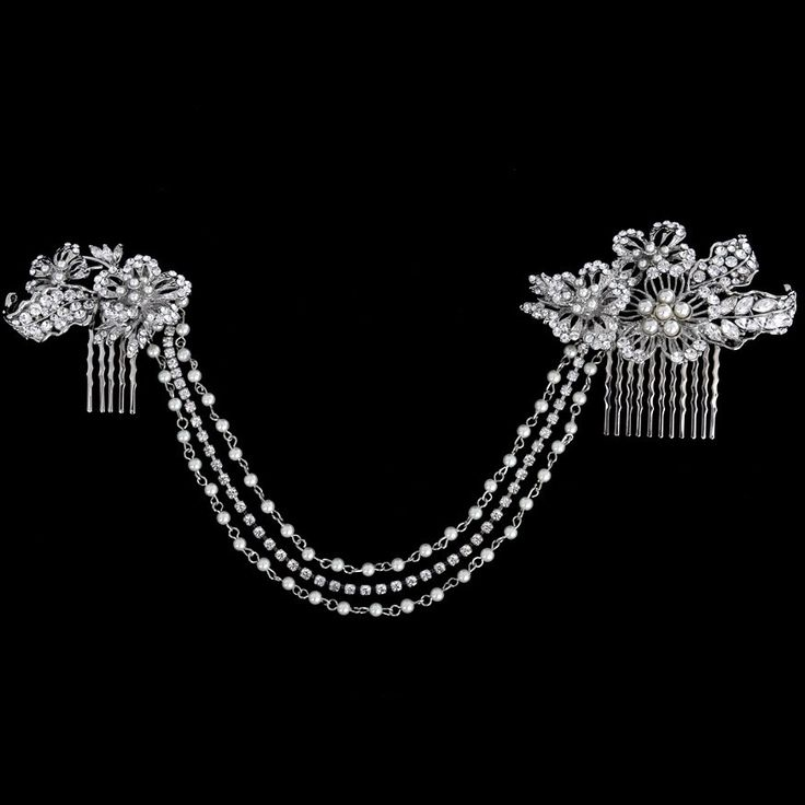 The Touquet Bridal Hair Vine is a luxurious piece designedto be worn across the forehead. Two cubic zirconia crystal and pearl combs are interlinked with three glamorous chains of crystals and petite simulated ivory pearls to create a truly glamorous look. Combs are designed for an easy fix into the hair. Measurement: Large crystal comb size is approx 6cm x4.5cm and small comb size is 3cm x 2.5cmPresented in Roman