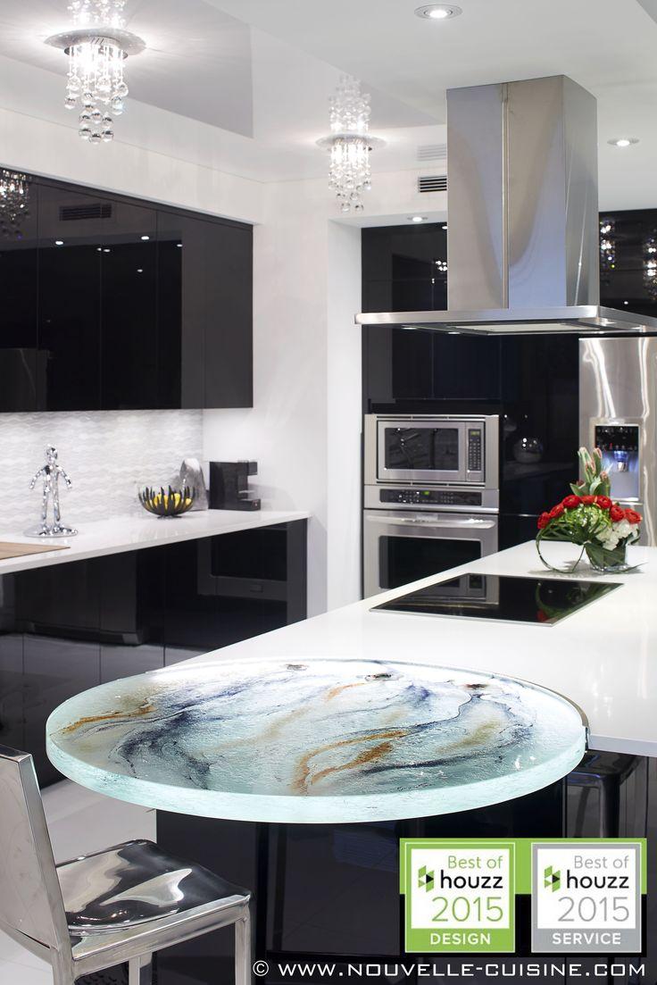 Modern kitchen with black acrylic cabinets. Custom glass countertop. / Cuisine moderne avec armoires en acrylique noire. Comptoir en verre sur mesure.
