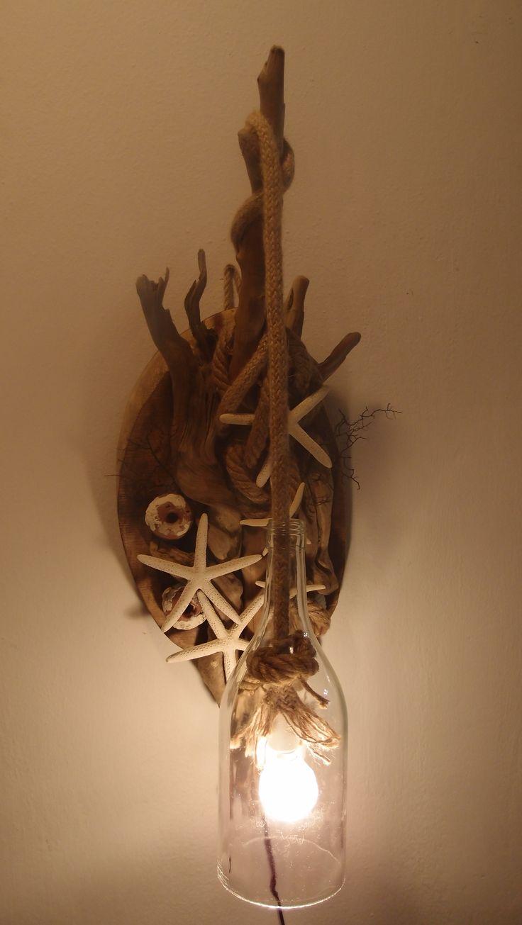 Απλίκα φωτιστικό από θαλασσοξυλα, σχοινί αστερίες& φελαδουρια..η λάμπα είναι μέσα σε μπουκάλι με κομμένο πάτο..υψος 65 cm..
