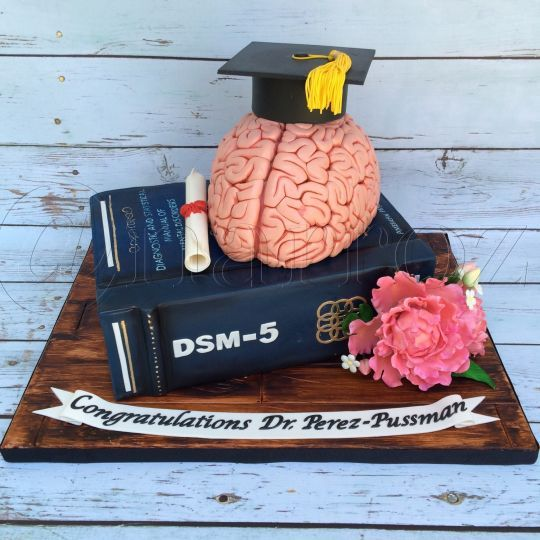 Psychology book and brain cake