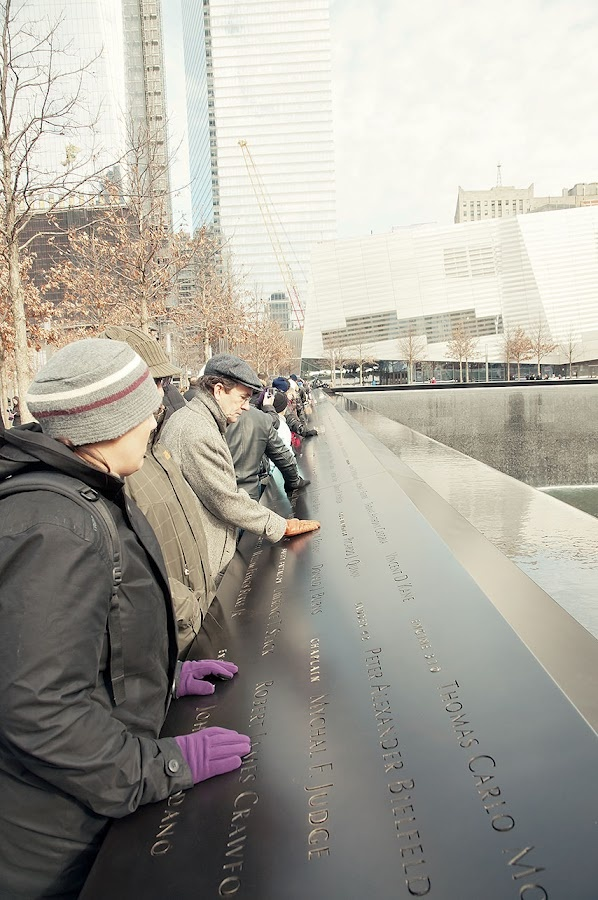 911 Memorial - the names of those who died are engraved around the pool on the towers' site.
