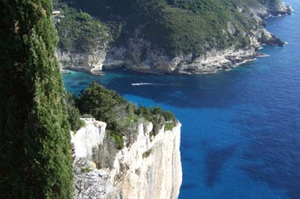 Paxos: The smallest of the Ionian Islands. A charming landscape of ancient olive groves, punctuated by thick groves of dark cypresses that seem to paint the sky an even brighter blue. #FiveStarGreece #LuxuryVillas #HolidayMatchmakers