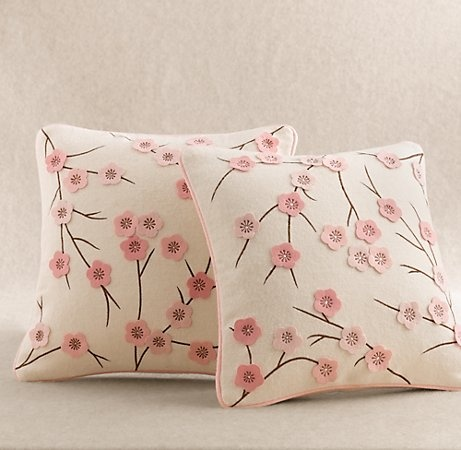 white pillow, fabric marker and felt? might be able to make these easy