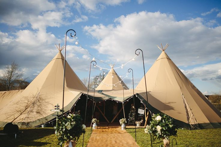 Three giant hat tipis with giant walkway - Sami Tipi Wedding by london-weddingphotographer