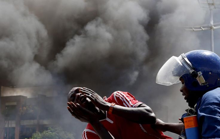 A detained protester cries in front of a burning barricade during a protest against President Pierre Nkurunziza's decision to run for a third term in Bujumbura, Burundi May 13, 2015. REUTERS/Goran Tomasevic