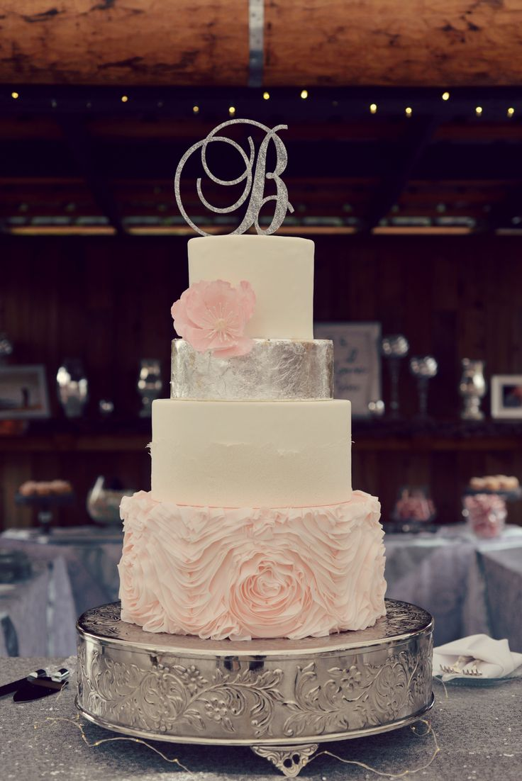 Four tiered rustic wedding cake with pink rosette ruffles, white lace and silver leaf, adorned with a large pink poppy! Country Cake Shop